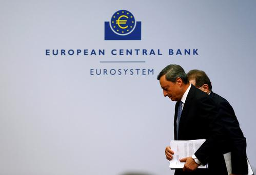 ECB president Mario Draghi and vice president Vitor Constancio leaving the news conference at the ECB headquarters in Frankfurt