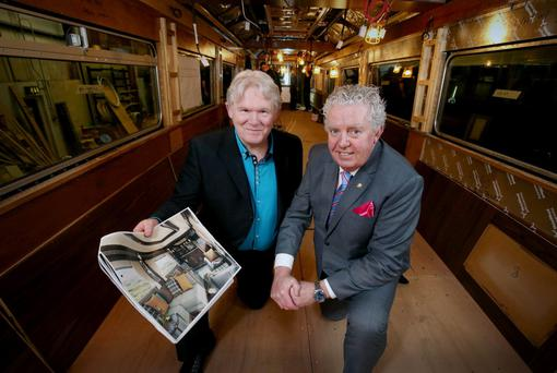 Neil Ward, Mivan ceo, and Brian McConville, Mivan owner, onboard a carriage facing work
