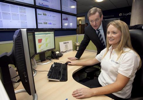 Taoiseach Enda Kenny at the opening of Fleetmatics' group global HQ in Dublin in 2013