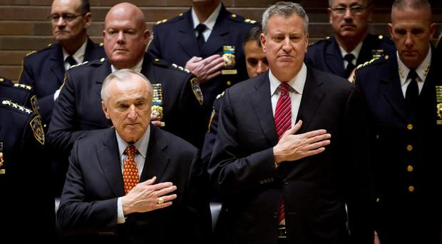 New York Police Commissioner Bill Bratton and Mayor Bill de Blasio take part in a New York Police Department promotion ceremony
