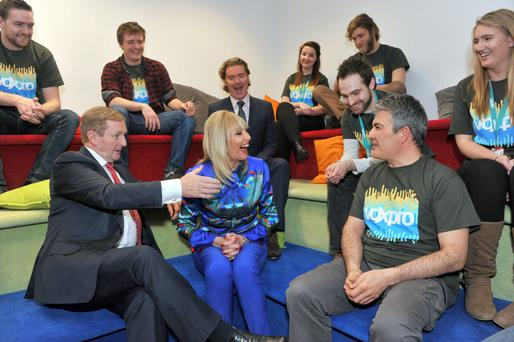 Taoiseach Enda Kenny meets Voxpro founders Linda and Dan Kiely, centre, at the company's Cork offices last year