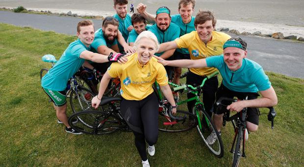 Deliveroo riders and the company's country manager, Oliver Dewhurst (in yellow), show their support for Olympic track cycling hopeful Shannon McCurley. The Rio contestant shared her expert tips on nutrition, fitness, road safety and bike maintenance to help strengthen Dublin riders' road biking knowledge. Photo: Conor McCabe.
