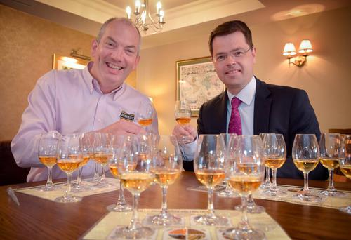 Northern Ireland Secretary James Brokenshire at the Bushmills Distillery in Bushmills, Co Antrim, with distillery managing director Colm Egan (left), as he begins canvassing public opinion on the implications of Brexit on a two-week tour of the North