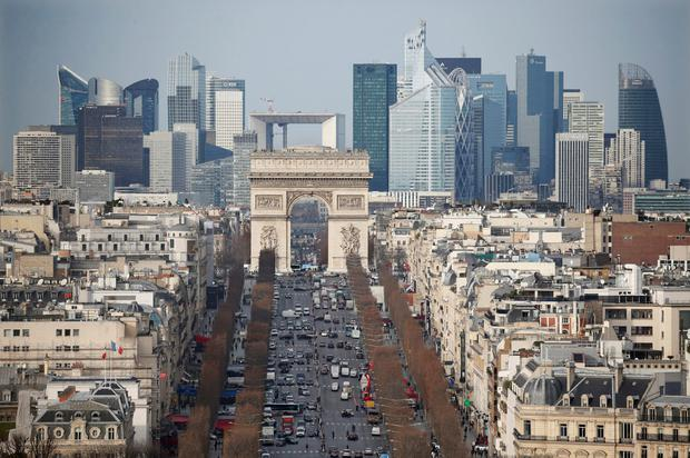The La Défense business heartland of Paris seen in the distance behind the Arc de Triomphe. France's private sector was on the up, despite Brexit and terror attacks on France itself. Photo: Reuters