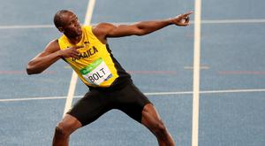 Jamaica's Usain Bolt celebrates winning the Men's 200 Metre final at Olympic Stadium on the thirteenth day of the Rio Olympic Games