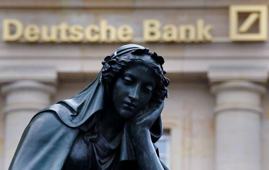 Deutsche's shares were down 3pc at €13.24 at lunchtime in London yesterday, underperforming in a weaker market. Photo: Reuters