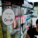 A Google sign in a phone shop in the city of Jakarta in Indonesia