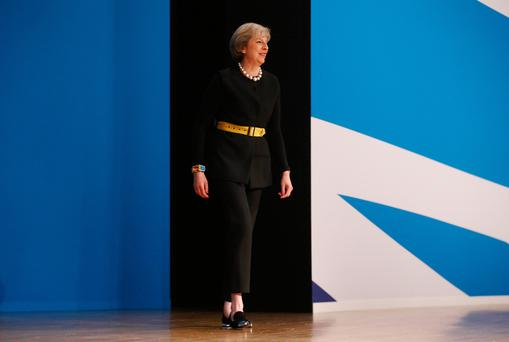 UK Prime Minister raises spectre of a 'hard Brexit' with her tough line on immigraton control. Photo: Bloomberg