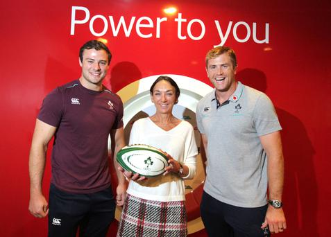 Vodafone's Anne Mulcahy pictured with rugby stars Robbie Henshaw and Jamie Heaslip