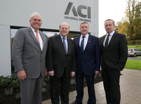 Philip Heasley, president and ceo, ACI Worldwide; Minister for Finance Michael Noonan; Minister for Employment and Small Business Pat Breen; and Leo Clancy, IDA head of technology