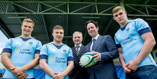 Josh van der Flier, Luke McGrath, Bobby Byrne, UCD director of rugby, Naoise Cosgrove, managing partner at Crowe Horwath, and Garry Ringrose announce deal