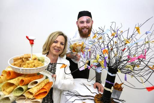 Sue O'Neill, who has highlighted the collective impact of small businesses, and chef John Grennan from Simpli Baked, at yesterday's SFA awards at Dublin's RDS. Photo: Gary O'Neilland
