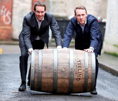 Jack Teeling, right, with brother Stephen outside the Teeling Whiskey distillery in Dublin, which was the city's first in more than 125 years