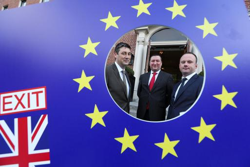 Economic activity picking up says Investec's Philip O'Sullivan, centre, pictured at a Brexit briefing earlier this year in Dublin