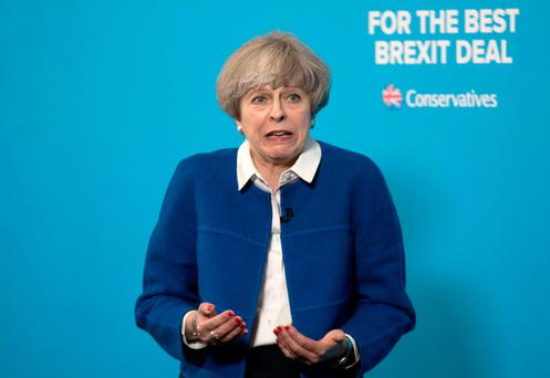 British Prime Minister Theresa May is fighting to sustain an overall majority in the House of Commons. Photo: PA