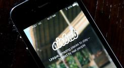 Websites and apps that facilitate peer-to-peer accommodation services include Airbnb. Photo: Getty Images