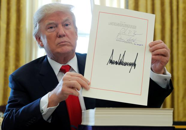 US President Donald Trump pictured after signing his $1.5trn tax overhaul plan in the White House before Christmaszone