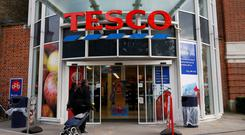 British retail giant Tesco has indicated that at least one proposed new store halted by the downturn could now restart because of the improved retail environment in Ireland. Photo: Reuters