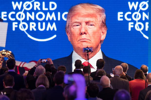 Davos delegates watch the appearance of US President Donald Trump on screen from an adjacent room at the World Economic Forum. Photo: AP