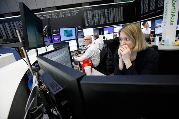 Traders monitoring financial data inside the Frankfurt Stock Exchange last week, as the equity rot continued to spread around global markets