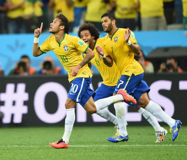 Neymar Jnr, left, in action for Brazil – he will be key to the country's World Cup hopes