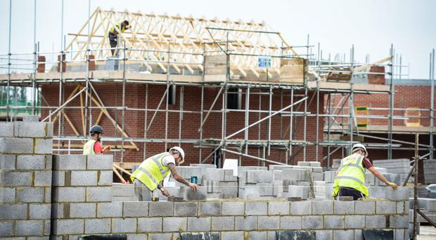 Construction bosses have appealed to thousands of builders who emigrated during the recession to return home, saying at least 112,000 more workers are needed.