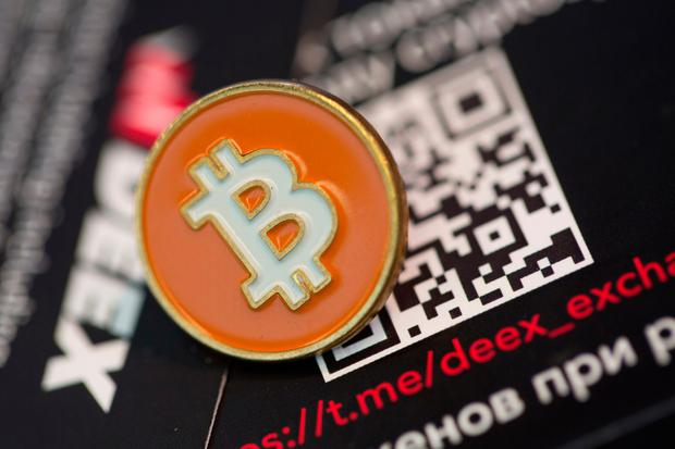 Experts say the trading of digital currencies or assets such as Bitcoin can become a behavioural addiction Photo: Bloomberg