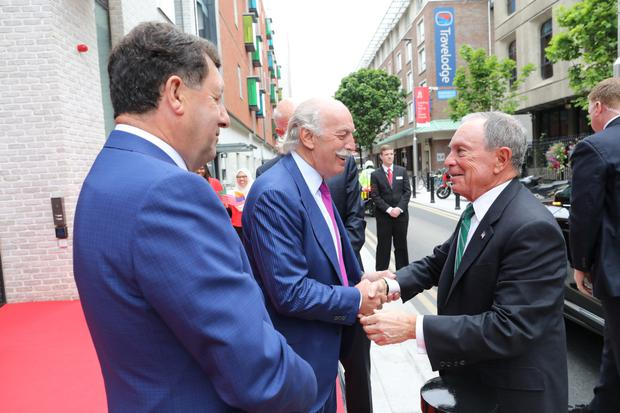 Michael Bloomberg, right, is greeted by businessman Dermot Desmond, centre, and Professor John Hyland, president of the Royal College of Surgeons in Ireland, as he arrives at the new €80m building on York Street