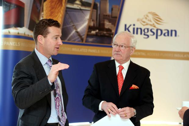 Kingspan CEO Gene Murtagh, left, with his father and company chairman Eugene Murtagh
