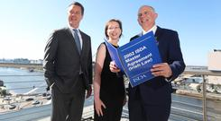 Scott O'Malia, CEO of the International Swaps and Derivatives Association; Judith Lawless, partner at McCann FitzGerald; and the Minister of State for the Department of Justice and Equality, David Stanton. Photo: Conor McCabe Photography