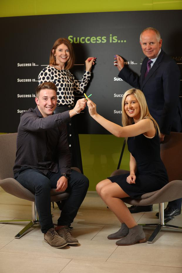 Orla Graham, Chief HR Officer and Brendan Jennings, Managing Partner, Deloitte, and (bottom left) graduates Ben Burns and Charlotte Corrigan. Picture Jason Clarke