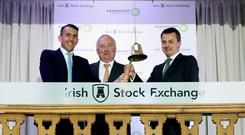 Powering ahead: Greencoat Capital partner Paul O'Donnell, chairman Ronan Murphy, and partner Bertand Gautier at the Irish Stock Exchange