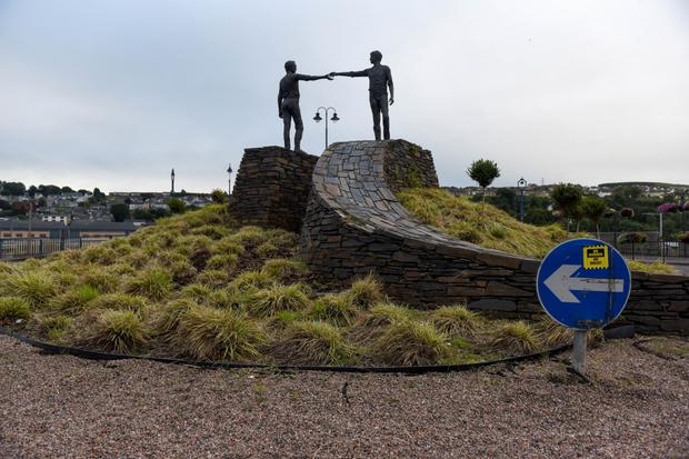 Reaching out : The 'Hands Across The Divide' sculpture in Derry – cross-border cooperation may have increased, but there is still a considerable distance between the two economies on either side of the Border