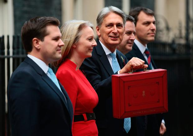 Box office: UK chancellor Philip Hammond shows off the traditional red box ahead of his Budget speech. Photo: Getty Images