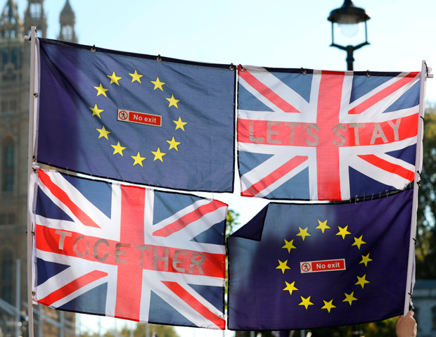 Flagging enthusiasm: European Union and British flags fly in front of the UK Houses of Parliament during a recent anti-Brexit march – Irish fears around Brexit have been reflected in the latest consumer sentiment index. Photo: Bloomberg