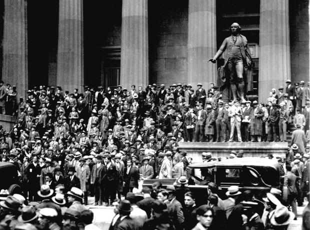 Boom to bust: Investors outside the stock exchange on Wall Street following the crash of 1929. Photo: AP