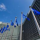 EU flags in front of European Commission in Brussels. Stock picture