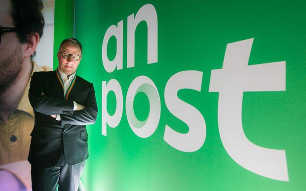 Stamp of approval: An Post CEO David McRedmond with the company's new logo. Photo: Gareth Chaney Collins