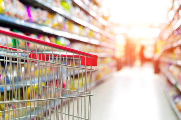Using a mobile phone on a trip to the supermarket pushes up shopping bills by 41pc on average, a study has found. Stock image