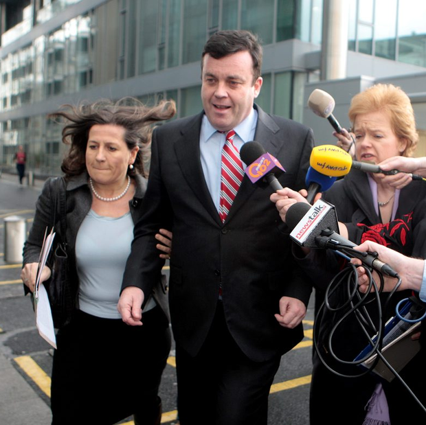 Former special adviser to the finance minister Cathy Herbert alongside Brian Lenihan as he is quizzed by members of the media in 2009
