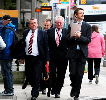 Deputy Ciaran Lynch (left), chairman of the Banking Inquiry, accompanied by Banking Inquiry investigators Pat McLoughlin and Peter Murray and, at back, press officer Ciaran Brennan at Leinster House yesterday.