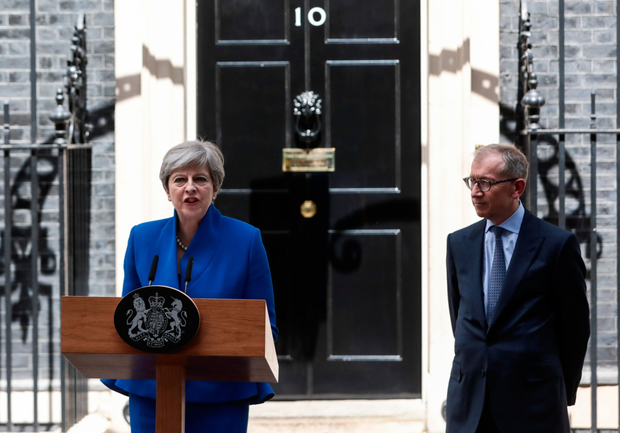 UK Prime Minister Theresa May delivers a speech as her husband, Philip May, watches outside number 10 Downing Street in London. Photo: Bloomberg