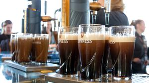 Pints of stout served at the Guinness Brewery