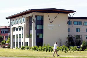 A man walks past Adobe Systems' headquarters at the CityWest complex in south Dublin