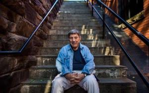 William Peter Blatty on the 'Exorcist Steps' in Georgetown where in the film a priest plummets to his death Credit: JIM LO SCALZO/EPA