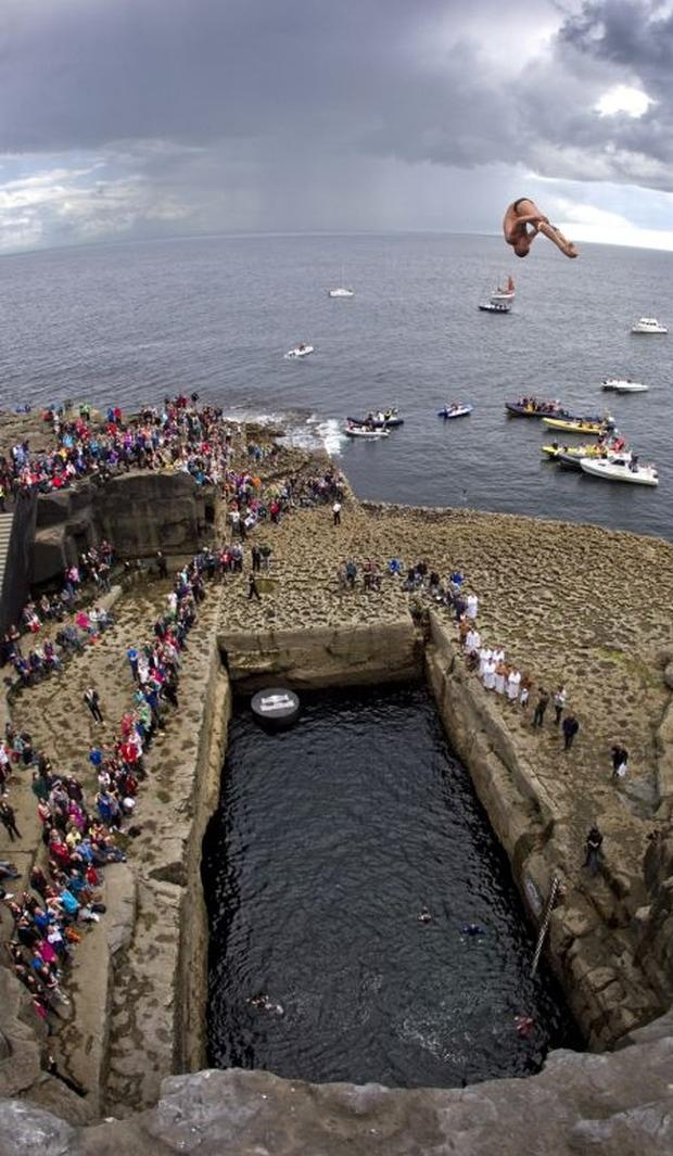 .Artem Silchenko of Russia dives from the 28 metre platform during the fourth stop of the Red Bull Cliff Diving World Series, Inis Mor, Aran Islands