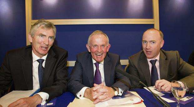 INM chairman Leslie Buckley (centre) with company secretary Michael Doorly (left) and Eamon O'Kennedy, chief financial officer.