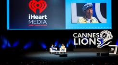 US TV host Ryan Seacrest and Grammy Award winner Pharrell Williams onstage as iHeartMedia hosts a talk about creativity during the Cannes Lions Festival at Grand Audi Theater, Palais