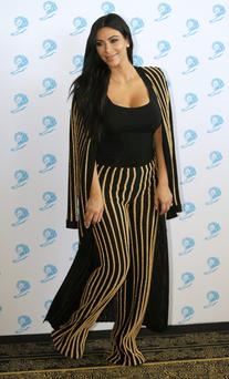 One of the most prominent women at the festival was celebrity Kim Kardashian, posing here at a photocall.