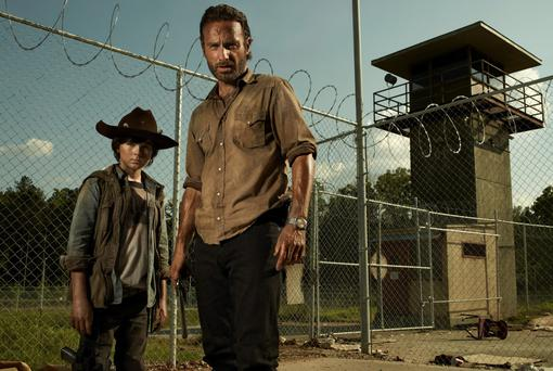 Chandler Riggas as Carl Grimes and Andrew Lincoln as Rick Grimes in the AMC horror series 'The Walking Dead'
